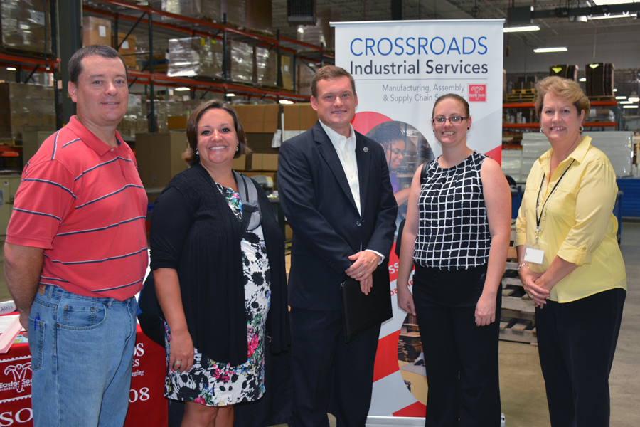 Group Photo of Brandon Herget, Senator Joe Donnelly's Indiana Regional Office Director, Crossroad Industrial Services, and INARF staff